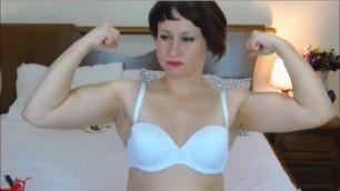 Cute MILF flexes her biceps